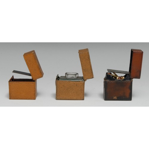 3505 - An early 20th century tan leather travelling inkwell, hinged cover, 4.5cm long, c.1920; a vesta case...
