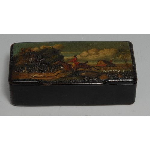 3074 - A 19th century papier mache rectangular snuff box, the hinged cover painted with a huntsman and houn...
