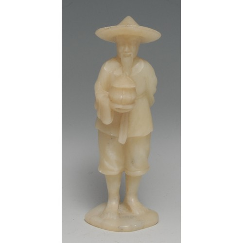 3158 - A Chinese soapstone figure, carved as a fisherman, 15.5cm high