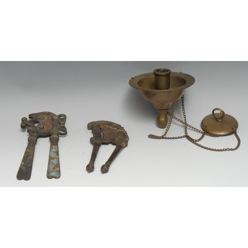 3545 - An Islamic brass hanging lamp, cylindrical candle sconce, broad rim above an inscription, 12cm diam;...
