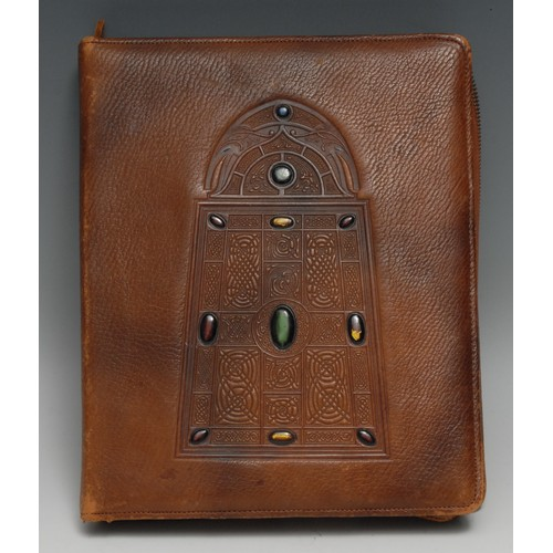 3373 - A Secessionist style leather desk companion, embossed in the Celtic taste and applied with cabochons...
