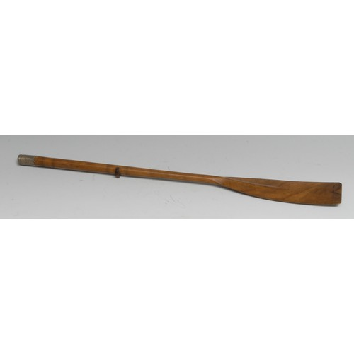 3504 - An early 20th century olivewood novelty page turner, as a rowing oar, 41.5cm long, c. 1910