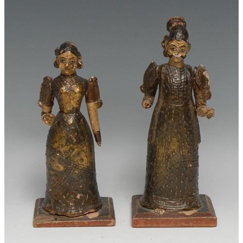 3327 - A pair of Indian softwood figures, of women in traditional dress, 21.5cm and 19cm high, probably Poo...