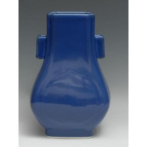 3117 - A Chinese archaistic monochrome arrow-shaped hu or vase, glazed in powder blue, geometric lug twin-h...