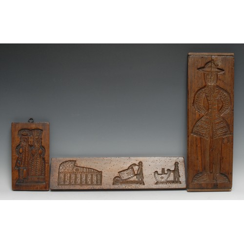 3725 - Treen - a large speculaas biscuit mould, intaglio carved with a lady in a traditional costume, 46cm ...