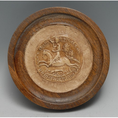 3282 - A museum-type cast impression, after a medieval seal, turned mahogany frame, 14.5cm diam overall