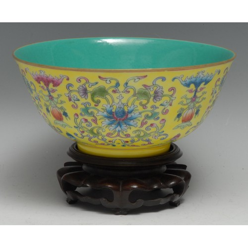3126 - A Chinese circular bowl, brightly painted in polychrome enamels with lotus scrolls and precious obje...