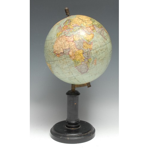 3488 - An early 20th century French terrestrial globe, by G. Thomas, Paris, ebonised stand, 38.5cm high