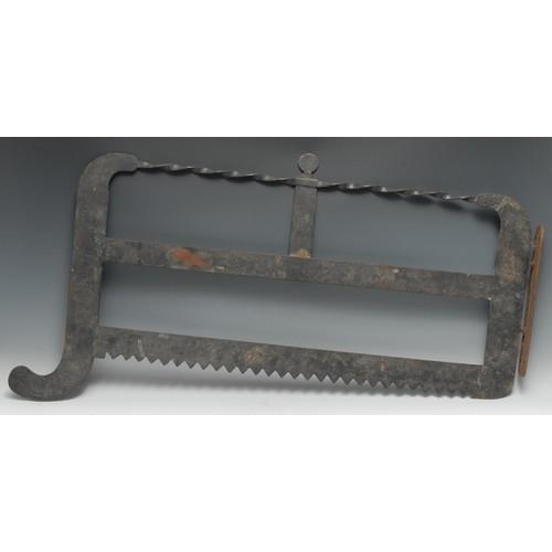3606 - Folk Art - an wrought iron shop sign, as an oversized saw, 94cm long