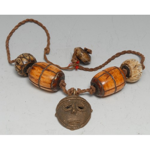 3732 - Tribal Art - an African necklace, composed of bone barrel shaped beads and a bronze 'passport' mask,...