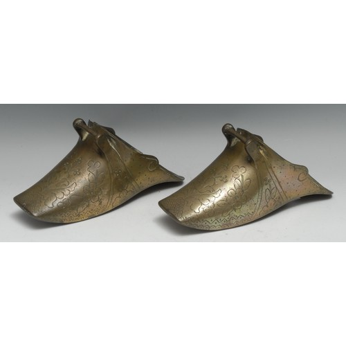 3342 - A pair of South American brass Conquistador stirrups, cast and chased with flowers, stiff leaves and...