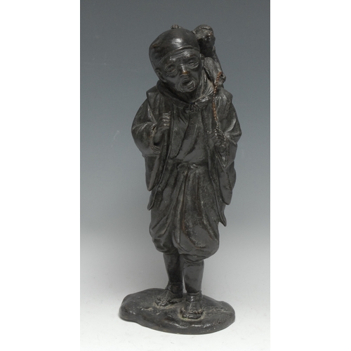 3635 - Japanese School (Meiji Period), a dark patinated bronze, of a labourer with a monkey, 32.5cm high