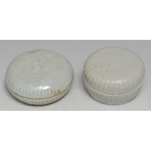 3708 - Shipwreck Porcelain - a Chinese pale celadon bun shaped box and cover, moulded with a bird amongst l...