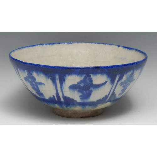 3267 - A Middle Eastern circular bowl, of Chinese and Islamic influence, thickly glazed in tones of cobalt ...