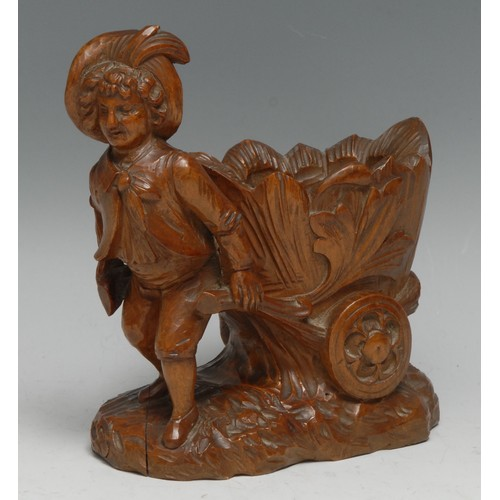 3099 - A Black Forest carving, of a gardner drawing a trolley, 14cm high, c.1900