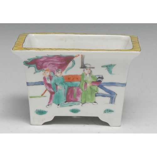 3151 - A Chinese rectangular jardiniere, decorated in the famille rose palette with warriors and figures of...