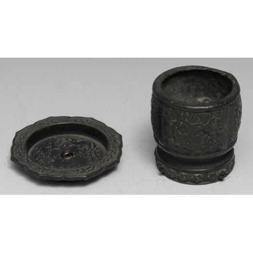 3129 - A Chinese dark patinated bronze brush washer, cast with scrolls on a ground of trellis, 5.5cm high; ...