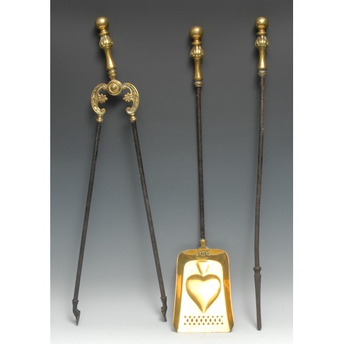 3375 - A set of 19th century brass and steel fire irons, comprising poker, tongs and shovel, the latter emb...