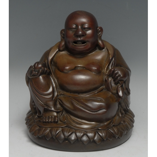 3574 - Chinese School (19th century), a brown patinated bronze, of Budai, seated upon a lotus holding a pea...