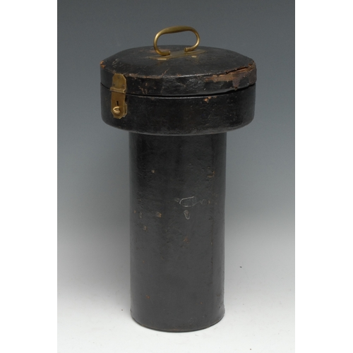 3556 - An unusual early 19th century brass-mounted lacquered leather travelling case, oversailing circular ...