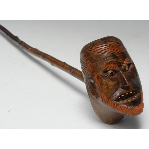 3603 - Folk Art - a late 19th century pipe, the bowl carved as the head of a bearded gentleman, grimacing g...