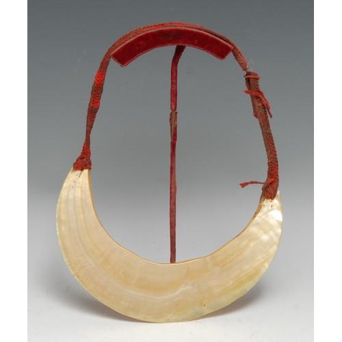3861 - Tribal Art - a Polynesian pearl shell neck ornament, 21.5cm wide, 18cm wide, display stand, Papua Ne...
