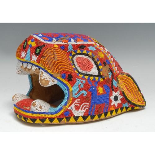 3855 - Tribal Art - a Huichol (aka Wixárika) beadwork jaguar head, decorated in brilliant colours on a natu...