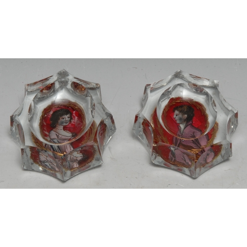 3308 - A pair of 19th century shaped oval salts, revesre painted with portraits of a lady and a gentleman, ...