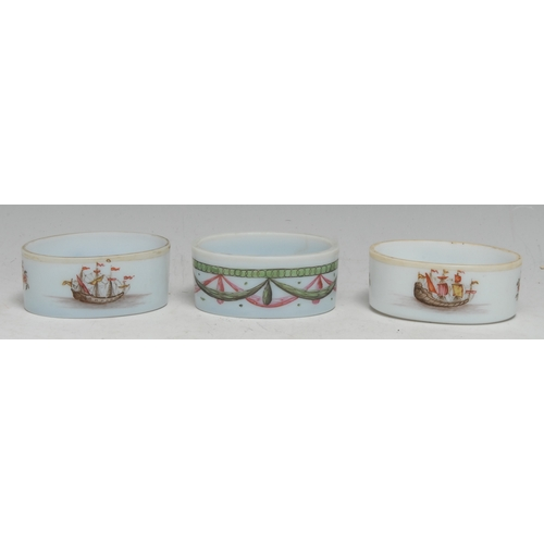 3071 - A 19th century opaline glass oval salt, the interior painted with a beetle, the side with drapery sw...