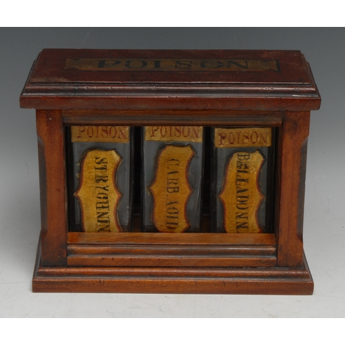 3457 - An apothecary's mahogany study decoration, the cabinet with hinged cover and open front enclosing th...