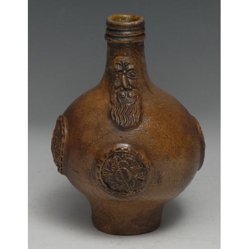 3001 - A 17th century Bellarmine brown salt-glazed stoneware jug, 21cm high, (restored and remodelled)  Pro...