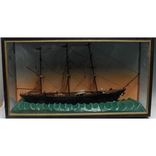 3260 - A maritime diorama, of a three-mast ship on a choppy sea, ebonised case, 45.5cm high, 84cm wide