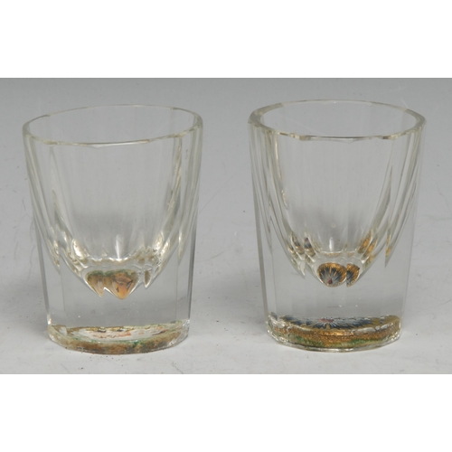 3757 - A Baccarat shot glass, the base interior painted with the head of a fox, the image reflected in the ...
