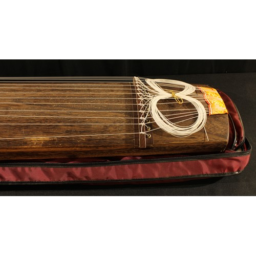 3690 - Musical instruments - a Chinese guzheng, 183cm long, carrying case