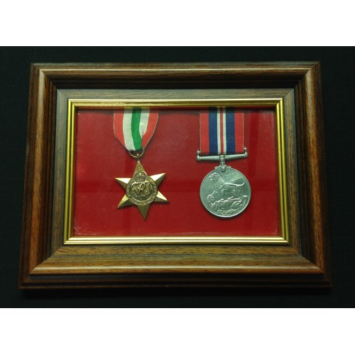 6 - WW2 British Italy Star and War Medal mounted in a frame. Complete with ribbons.