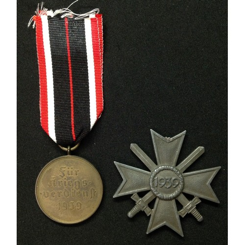19 - WW2 Third Reich Kriegsverdienstmedaille - War Merit Medal. No makers mark to ring. Complete with rib...