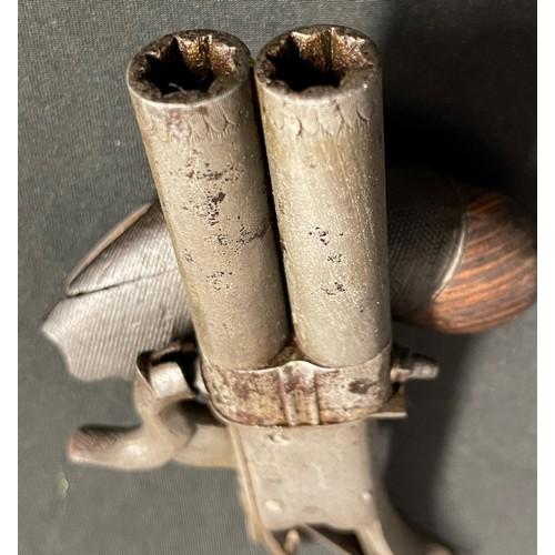 40 - A small revolving double barrel Percussion cap pistol. Barrel length 67mm. Heavily rifled bore appro...