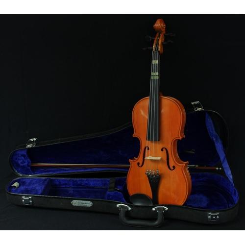 29 - A Chinese Skylark practice violin, cased; another similar practice violin, cased (2)