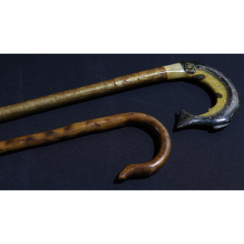 39 - A fen walking stick, the handle modelled as a trout; another walking stick (2)