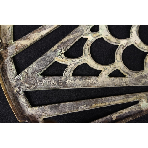 15 - An early 20th century brass trivet, by William Tonks & Sons, Birmingham, 40.5cm wide, c.1910