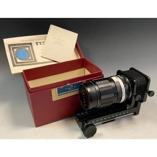 28 - A 1960's electric monocular microscope, cased; a Russian reflex camera lens (2)