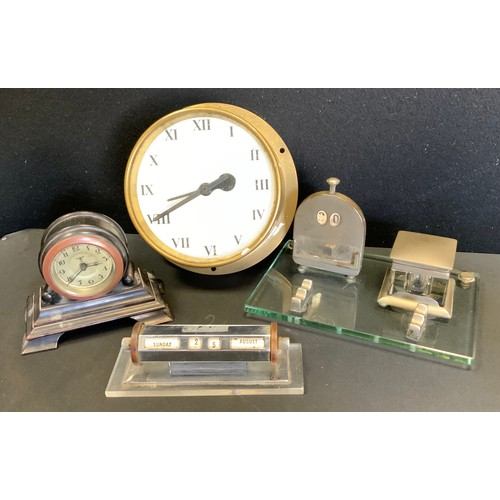 37 - An early 20th century ebony cased desk timepiece, silvered dial, Arabic numerals, stepped case;  a S...