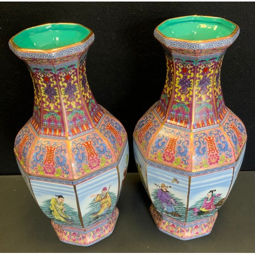 44 - A pair of contemporary Chinese octagonal vases, each side decorated with a figural panel, multi colo...