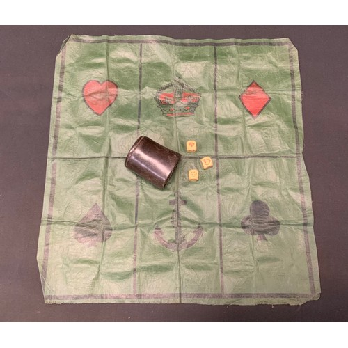 45 - A game of Crown & Anchors with cloth 'board', dice and cup