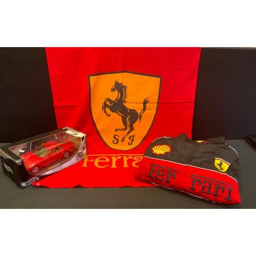 52 - Motor Racing interest - a Burago Ferrari model Scaglietti 612 model car, boxed;  XXL black jacket et...