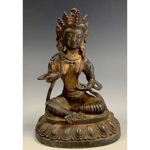 53 - A contemporary bronzed metal figure as a seated goddess, possibly Tibetan, 20cm high.