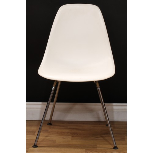 16 - Modern Design - a set of four DSX chairs, designed by Charles and Ray Eames, and produced by Vitra, ...