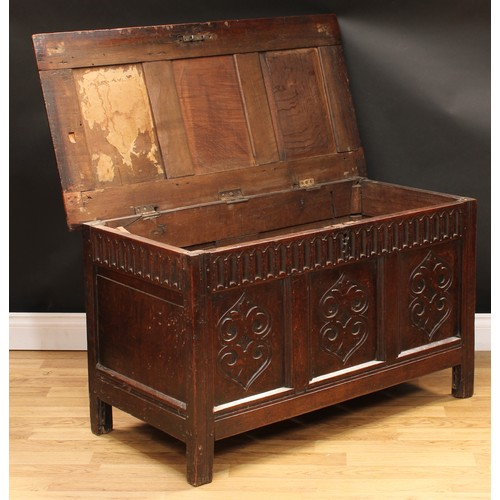49 - A late 17th/early 18th century oak three panel blanket chest, of small proportions, hinged cover, nu...