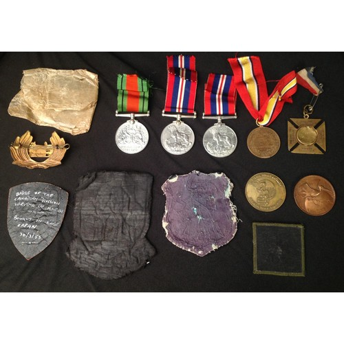 29 - WW2 British War Medals x 2 with packets and a Defence Medal along with a selection of mixed militari...