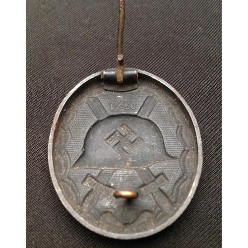 50 - WW2 Third Reich Verwundetenabzeichen 1939 in Schwarz - Wound badge 1939 in Black. Maker marked L/56....